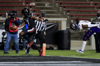 Cincinnati wide receiver Tre Tucker, left, makes a catch for a touchdown in front of East Carolina defensive back Juan Powell, right, during the first half of an NCAA college football game Friday, Nov. 13, 2020, in Cincinnati. (AP Photo/Aaron Doster)