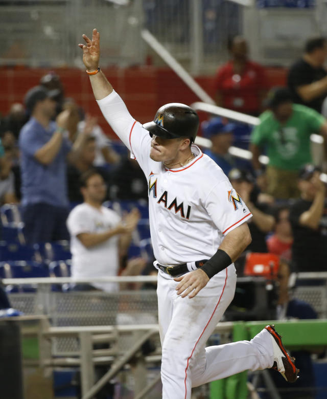 Miami Marlins' Justin Bour celebrates as he heads for home after hitting a home run during the fourth inning of a baseball game against the Milwaukee Brewers, Wednesday, July 11, 2018, in Miami. (AP Photo/Wilfredo Lee)