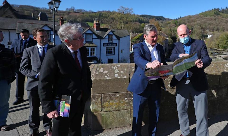 Mark Drakeford (left) listens as Labour's leader, Keir Starmer (centre), talks to the AONB partnership chair, Andy Worthington, during a walkabout in Llangollen for Welsh Labour's Senedd election campaign.