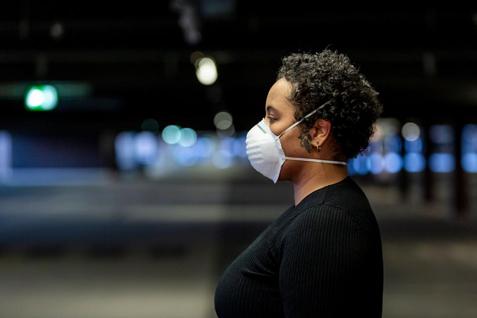 The COVID-19 pandemic was (and still is) extremely traumatizing — and the effects of that may show up in our lives for quite some time. Here's what to look out for. (Photo: EMS-FORSTER-PRODUCTIONS via Getty Images)