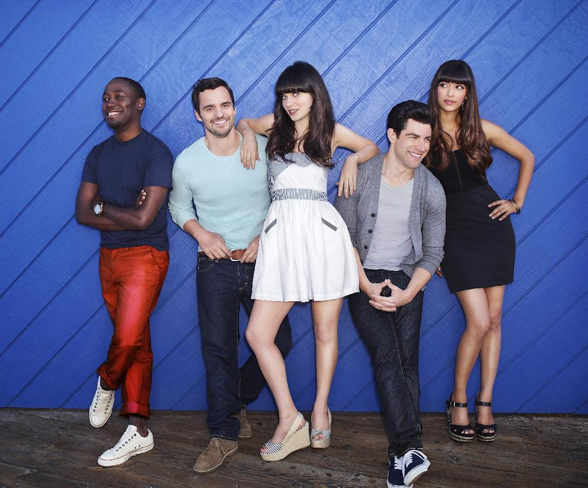 """In this publicity photo released by FOX, """"New Girl"""" cast from left, Lamorne Morris, Jake Johnson, Zooey Deschanel, Max Greenfield and Hannah Simone are shown. The second season of """"New Girl"""" premieres Tuesday, Sept. 25 with an all new episode airing at (8:00-8:30 PM ET/PT) and the season premiere episode airing at (9:00-9:30 PM ET/PT) on FOX. Newcomers """"Girls"""" and """"New Girl"""" are vying for honors in the comedy series for the 64th Primetime Emmy Awards. Nominations are announced Thursday, July 19, 2012.  (AP Photo/FOX, Dewey Nicks)"""