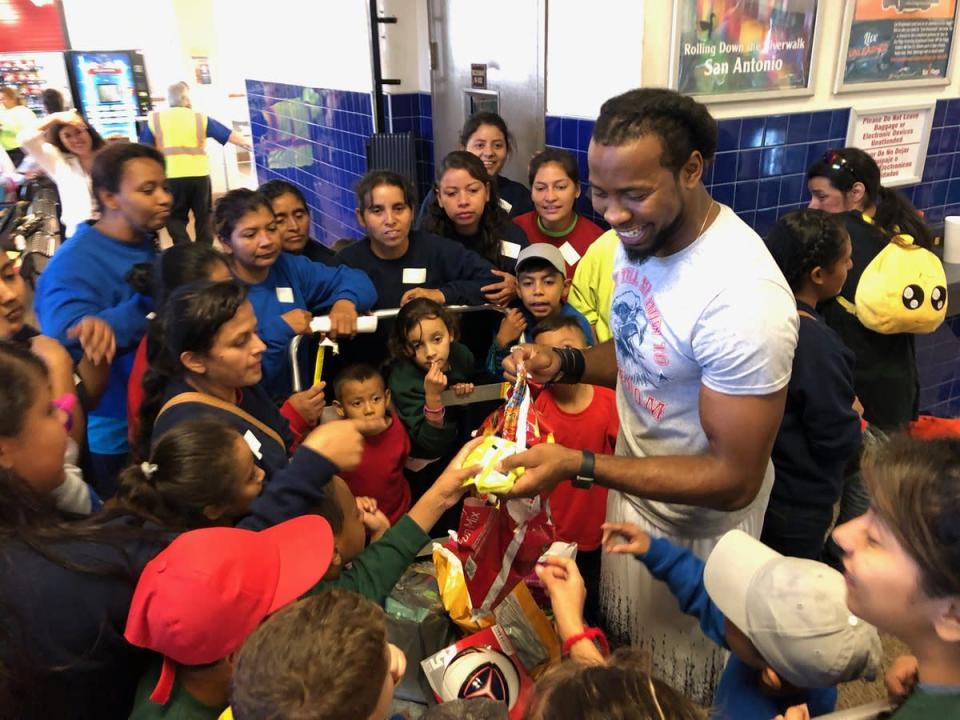 Washington CB Josh Norman, right, and Saints LB Demario Davis gave backpacks and toys to migrant children in Texas. (Norman Twitter)