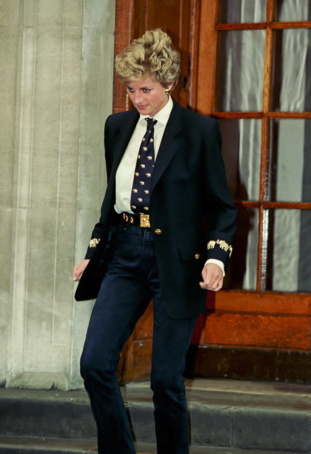 <p>Later in her life, Diana embraced a more chic verson of androgyny, pairing a tie with a gold-embellished jacket and fitted pants. (Photo: Julian Parker/UK Press via Getty Images) </p>