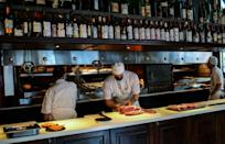 A chef prepares grilled beef at the famous Don Julio restaurant in Buenos Aires' trendy Palermo district