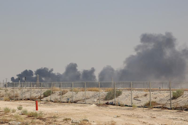 TOPSHOT - Smoke billows from an Aramco oil facility in Abqaiq about 60km (37 miles) southwest of Dhahran in Saudi Arabia's eastern province on September 14, 2019. - Drone attacks sparked fires at two Saudi Aramco oil facilities early today, the interior ministry said, in the latest assault on the state-owned energy giant as it prepares for a much-anticipated stock listing. Yemen's Iran-aligned Huthi rebels claimed the drone attacks, according to the group's Al-Masirah television. (Photo by - / AFP) (Photo credit should read -/AFP/Getty Images)