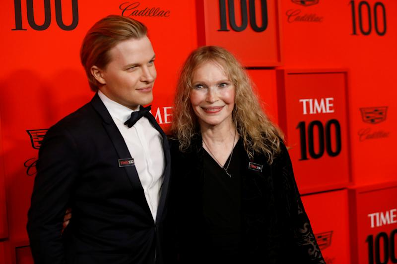 Journalist Ronan Farrow poses with his mother, actor Mia Farrow as they arrive for the Time 100 Gala celebrating Time magazine's 100 most influential people in the world in New York, U.S., April 23, 2019. REUTERS/Andrew Kelly