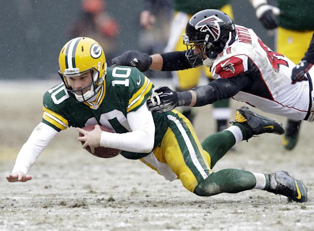 Atlanta Falcons' Zeke Motta tackles Green Bay Packers quarterback Matt Flynn (10) during the first half of an NFL football game Sunday, Dec. 8, 2013, in Green Bay, Wis. (AP Photo/Tom Lynn)