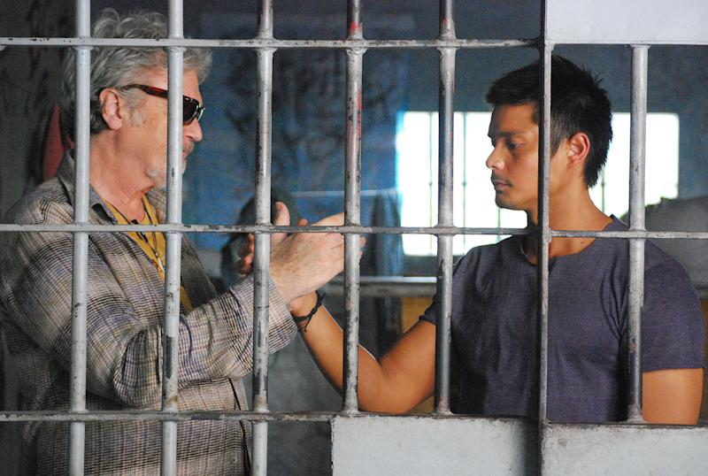 "In this handout photo taken March, 2010 and released by Portfolio Films Wednesday, April 3, 2013, Irish actor Patrick Bergin, left, and Filipino heartthrob Dingdong Dantes perform during a scene at the Cebu Provincial Detention and Rehabilitation Center in Cebu province, central Philippines. The Filipino inmates whose choreographed ""Thriller"" dance has attracted 52 million YouTube hits since 2007 are getting their own stories told in a movie ""Dance of the Steel Bars"". (AP Photo/Portfolio Films) NO SALES"