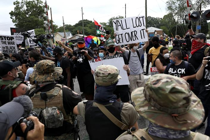 "<div class=""inline-image__caption""><p>Scuffles broke out between rival groups before police moved in.</p></div> <div class=""inline-image__credit"">Dustin Chambers/Reuters</div>"