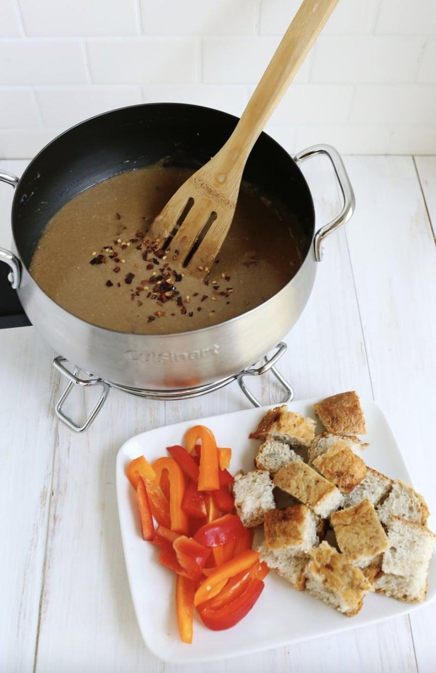 "<p>Looking for a whole new kind of fondue? This cheese-filled recipe is for you. Made with sharp cheddar, garlic, chipotle pepper, and stout beer, you'll get a range of flavors like never before. </p> <p><strong>Get the recipe</strong>: <a href=""https://abeautifulmess.com/spicy-stout-cheese-fondue/"" class=""link rapid-noclick-resp"" rel=""nofollow noopener"" target=""_blank"" data-ylk=""slk:spicy and stout cheese fondue"">spicy and stout cheese fondue</a></p>"