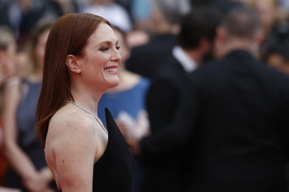 """71st Cannes Film Festival - Screening of the film """"Yomeddine"""" in competition - Red Carpet Arrivals - Cannes, France May 9, 2018.  Actor Julianne Moore poses. REUTERS/Stephane Mahe"""