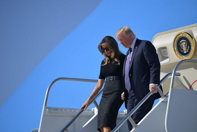 President Donald Trump and first lady Melania Trump step off Air Force One upon arrival at McCarran International Airport in Las Vegas on Oct. 4, 2017.