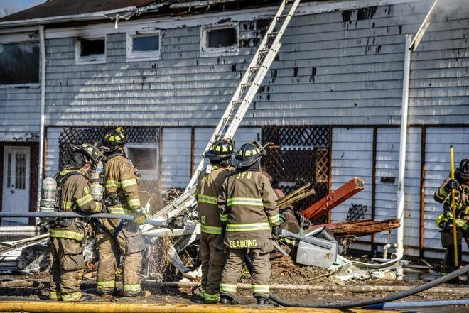 Firefighters work the scene of a blaze at Jamestown Golf Course on Saturday.