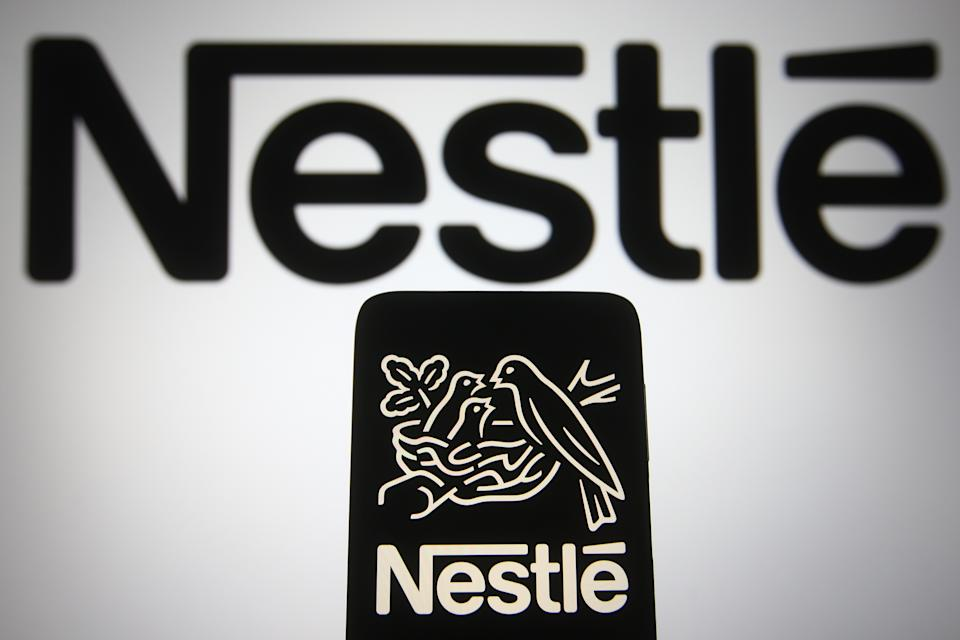 UKRAINE - 2021/03/30: In this photo illustration the Nestle logo is seen on a smartphone and a pc screen. (Photo Illustration by Pavlo Gonchar/SOPA Images/LightRocket via Getty Images)