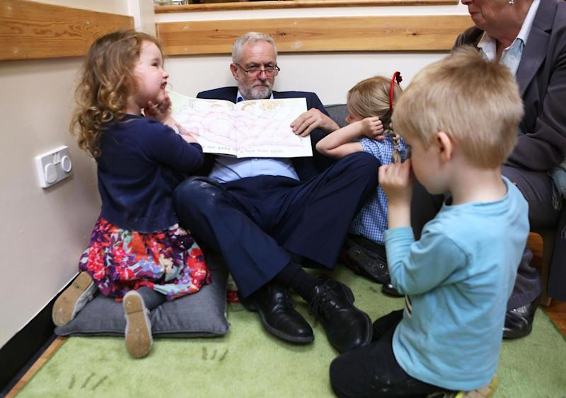 He read to the group of schoolchildren ahead of the snap general election on June 8 (PA)