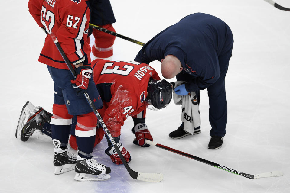 Washington Capitals right wing Tom Wilson (43) receives attention after an injury during the first period of the team's NHL hockey game against the Philadelphia Flyers, Saturday, May 8, 2021, in Washington. (AP Photo/Nick Wass)