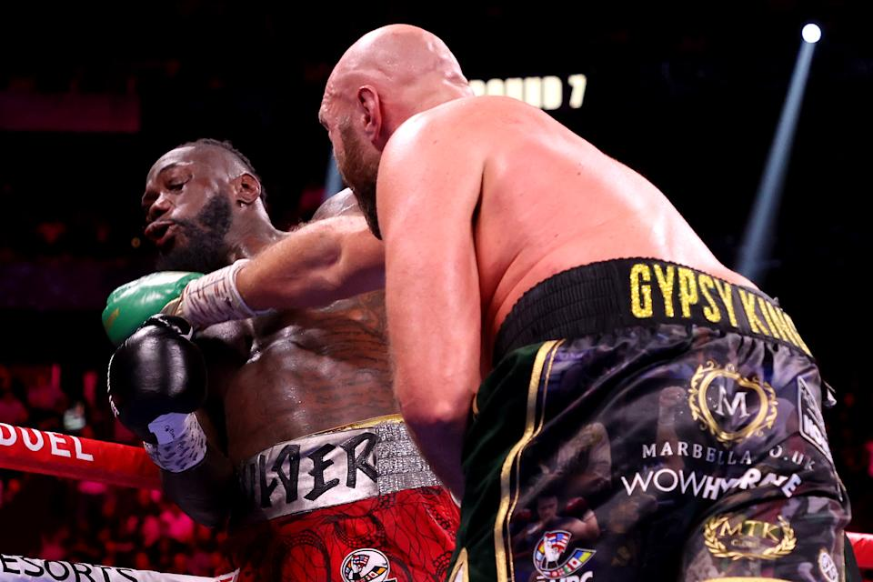Seen here, Tyson Fury (R) punches Deontay Wilder during their WBC heavyweight title fight  in Las Vegas.