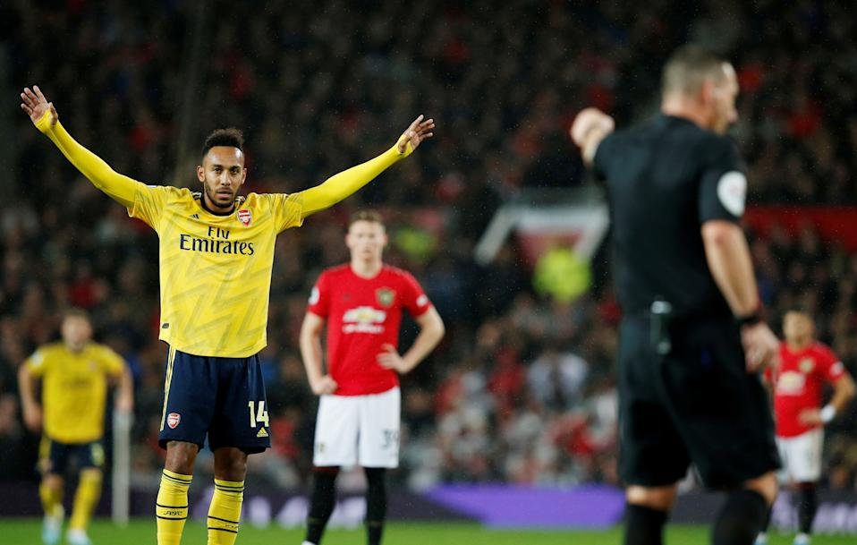 "Soccer Football - Premier League - Manchester United v Arsenal - Old Trafford, Manchester, Britain - September 30, 2019   Arsenal's Pierre-Emerick Aubameyang reacts after referee awards the goal after a VAR review    REUTERS/Andrew Yates    EDITORIAL USE ONLY. No use with unauthorized audio, video, data, fixture lists, club/league logos or ""live"" services. Online in-match use limited to 75 images, no video emulation. No use in betting, games or single club/league/player publications.  Please contact your account representative for further details."