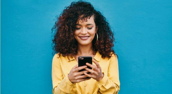 Woman uses a mobile trading app