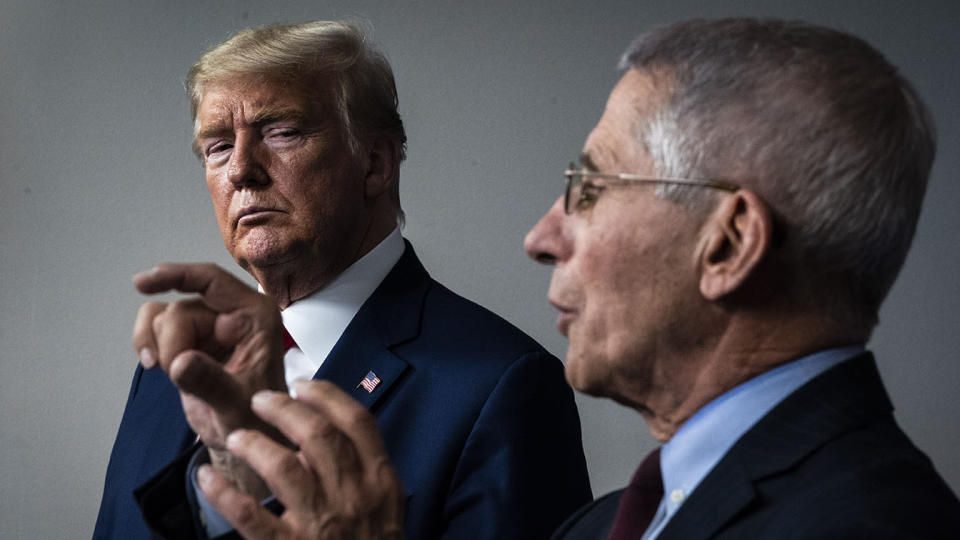 President Donald Trump listens as Dr. Anthony Fauci speaks during a briefing on the coronavirus pandemic in March 2020. (Jabin Botsford/The Washington Post via Getty Images)