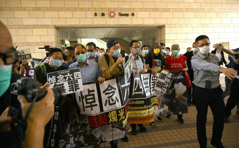 Pro-democracy activists demonstrate outside the West Kowloon court in Hong Kong in support of media mogul Jimmy Lai -- the US is sanctioning Hong Kong officials accused of curbing freedoms in the city