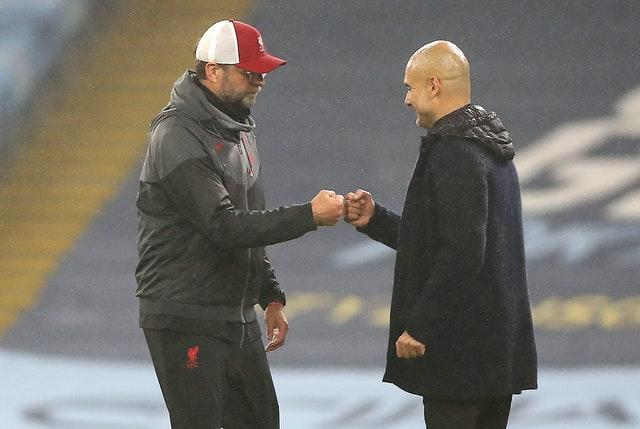 Jurgen Klopp (left) and Pep Guardiola (right) both complained about the Premier League schedule after Liverpool drew 1-1 at Manchester City