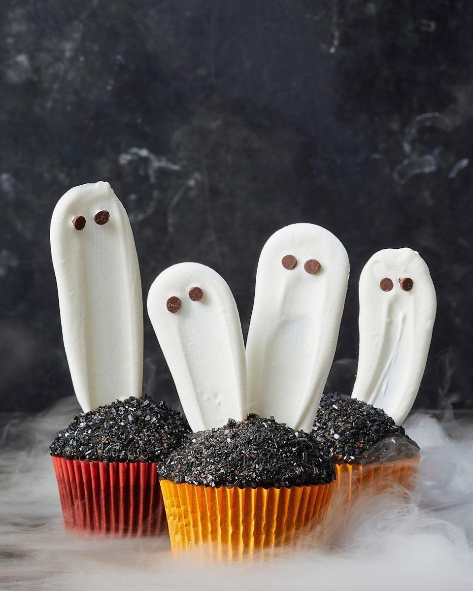 """<p>Let these ghostly guys rise up from the ashes of a delicious chocolate cupcake.</p><p><em><a href=""""https://www.goodhousekeeping.com/food-recipes/party-ideas/a28591745/white-chocolate-ghost-cupcakes-recipe/"""" rel=""""nofollow noopener"""" target=""""_blank"""" data-ylk=""""slk:Get the recipe for Ghost Cupcakes »"""" class=""""link rapid-noclick-resp"""">Get the recipe for Ghost Cupcakes »</a></em> </p>"""