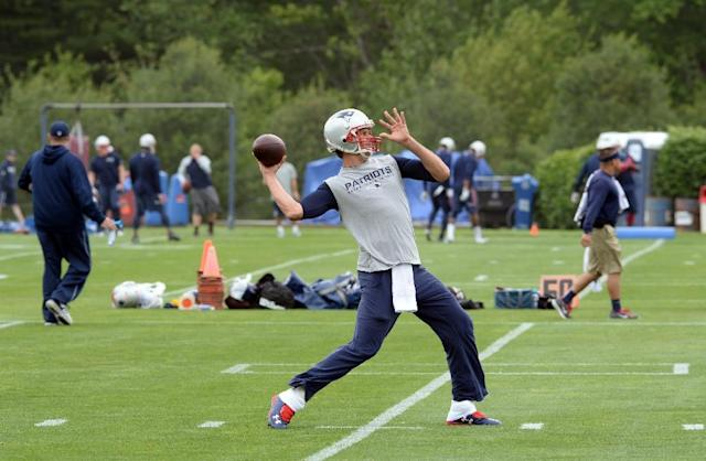 Tom Brady #12 of the New England Patriots throws a ball during organized team activities at Gillette Stadium on June 4, 2015 in Foxborough, Massachusetts (AFP Photo/Darren Mccollester)