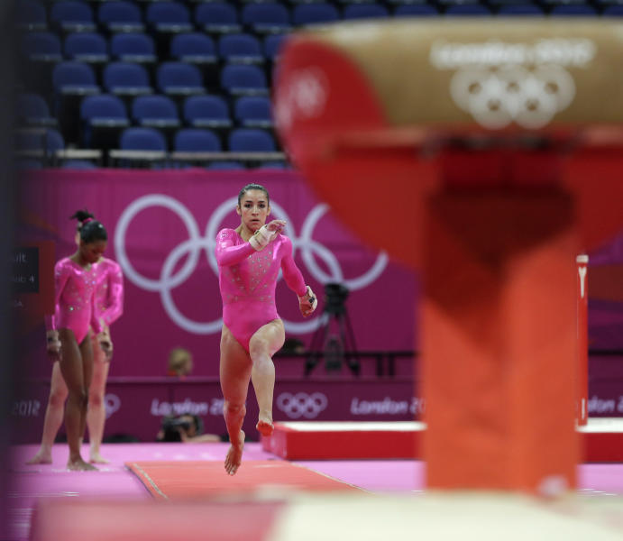 U.S. gymnast Alexandra Raisman performs on the vault during training at the 2012 Summer Olympics, Thursday, July 26, 2012, in London. (AP Photo/Julie Jacobson)