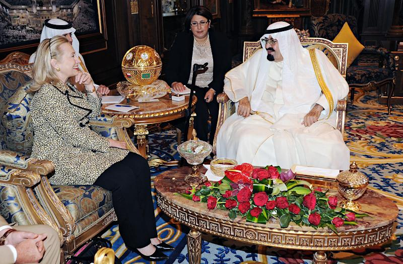 In this photo released by Saudi Press Agency, King Abdullah of Saudi Arabia, right, meets with Secretary of State Hillary Rodham Clinton in Riyadh, Saudi Arabia, Friday, March 30, 2012. Clinton sought to work out a unified strategy on the crisis in Syria in talks with Saudi officials on Friday as further violence stymied U.N. efforts to convince Damascus to implement a cease-fire. (AP Photo/HO) EDITORIAL USE ONLY