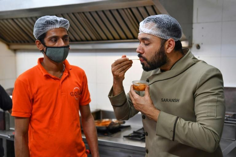 Indian celebrity chef Saransh Goila (R) has been called the maker of the world's 'best butter chicken' by MasterChef Australia