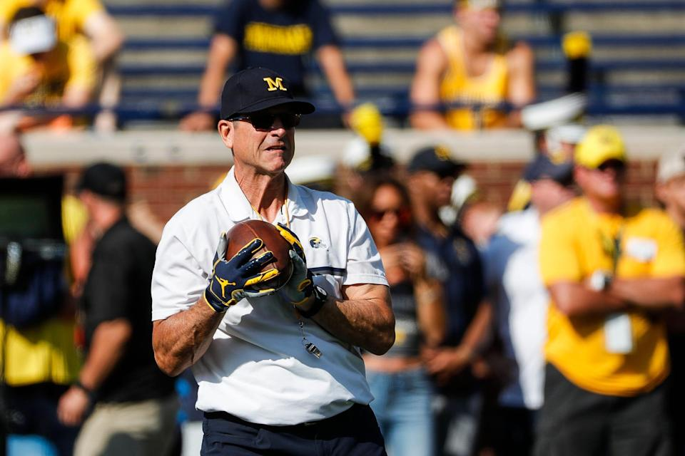 Michigan head coach Jim Harbaugh during warm up before a game against Northern Illinois at Michigan Stadium in Ann Arbor on Saturday, Sept. 18, 2021.