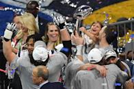 <p>Quarterback for the New England Patriots Tom Brady (R) his daughter Vivian Lake Brady and teammates celebrate after winning Super Bowl LIII against the Los Angeles Rams at Mercedes-Benz Stadium in Atlanta, Georgia, on February 3, 2019. (Photo by Angela Weiss / AFP) </p>