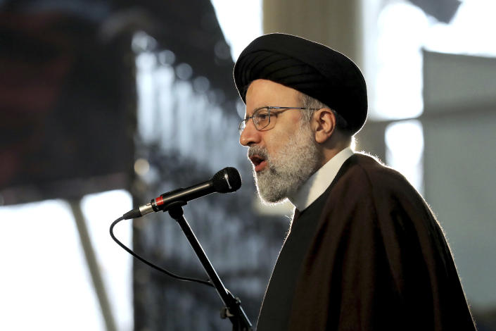 Ebrahim Raisi, Head of Iran's Judiciary, speaks during a ceremony on the occasion of first anniversary of death of late Iranian Revolutionary Guards Corps (IRGC) general and commander of the Quds Force Qasem Soleimani, in Tehran, Iran, Friday, Jan. 1, 2021. The top commander of Iran's paramilitary Revolutionary Guard said Friday that his country was fully prepared to respond to any U.S. military pressure, amid heightened tensions between Tehran and Washington in the waning days of President Donald Trump's administration. (AP Photo/Ebrahim Noroozi)