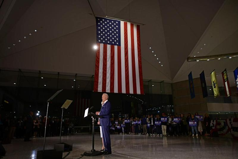 Joe Biden addresses the media and a small group of supporters with his wife Dr Jill Biden during a primary night event on 10 March in Philadelphia, Pennsylvania.