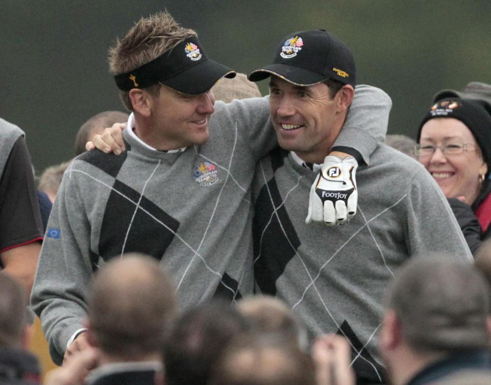 FILE - Europe's Ian Poulter, left, and Padraig Harrington react during a practice round at the 2010 Ryder Cup golf tournament in Newport, Wales, in this Tuesday, Sept. 28, 2010, file photo. Poulter comes into the seventh Ryder Cup of his career ranked 50th, the worst standing of any of the 24 players who will tee it up beginning Friday, Sept. 24, 2021. But there was never a hint of doubt that Padraig Harrington would use one of his captain's picks to make sure the 45-year-old Englishman, an avid Arsenal fan who is also a sports car collector, would be on the team. (AP Photo/Matt Dunham, File)