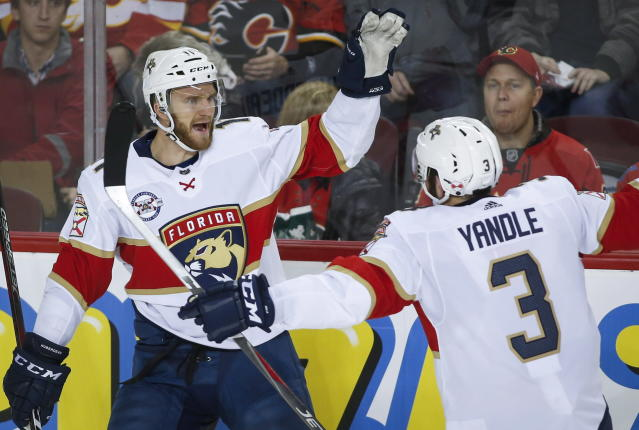 Florida Panthers' Jonathan Huberdeau, left, celebrates his goal with teammate Keith Yandle during second-period NHL hockey game action against the Calgary Flames in Calgary, Alberta, Friday, Jan. 11, 2019. (Jeff McIntosh/The Canadian Press via AP)