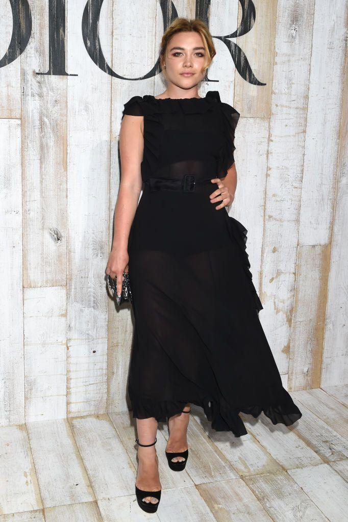 <p>She chose a sheer, black midi dress to the Christian Dior Couture S/S19 Cruise Collection, May 2018.</p>