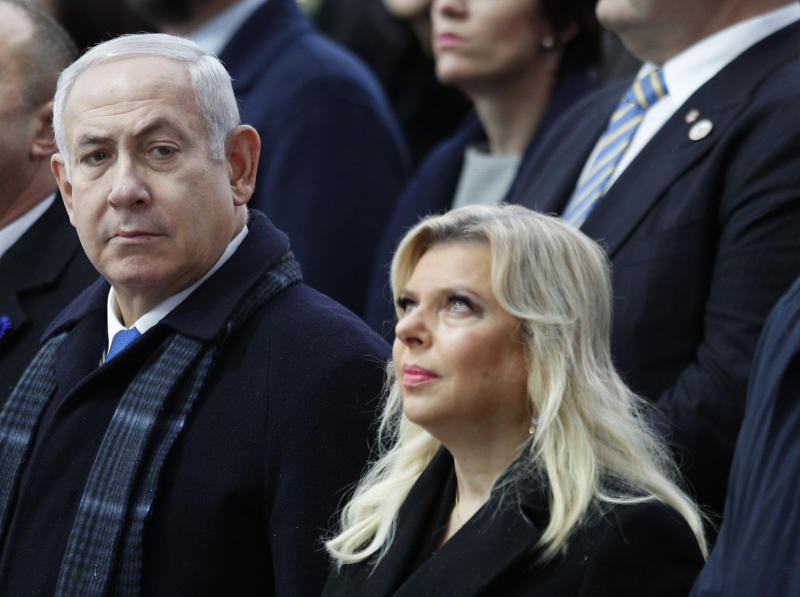 FILE - In this Nov. 11, 2018, file photo, Israeli Prime Minister Benjamin Netanyahu and his wife Sara attend ceremonies at the Arc de Triomphe in Paris. Prosecutors said Wednesday, June 12, 2019, that Sara Netanyahu, has agreed to a plea bargain settling allegations that she misused some $100,000 of state money on lavish meals. The State Attorney's office said Mrs. Netanyahu will pay roughly $15,000 in fines to close the case, which accused her of running up large tabs at luxury restaurants while hiding that the official residence employed a full-time chef. (AP Photo/Francois Mori, Pool, File)