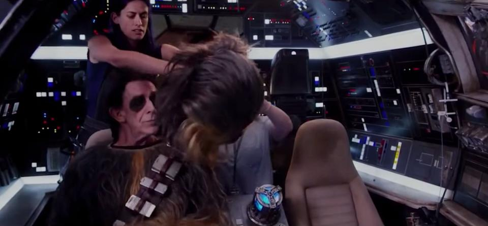 """Peter Mayhew getting into costume in """"Star Wars: The Force Awakens."""" (Photo: Lucasfilm)"""