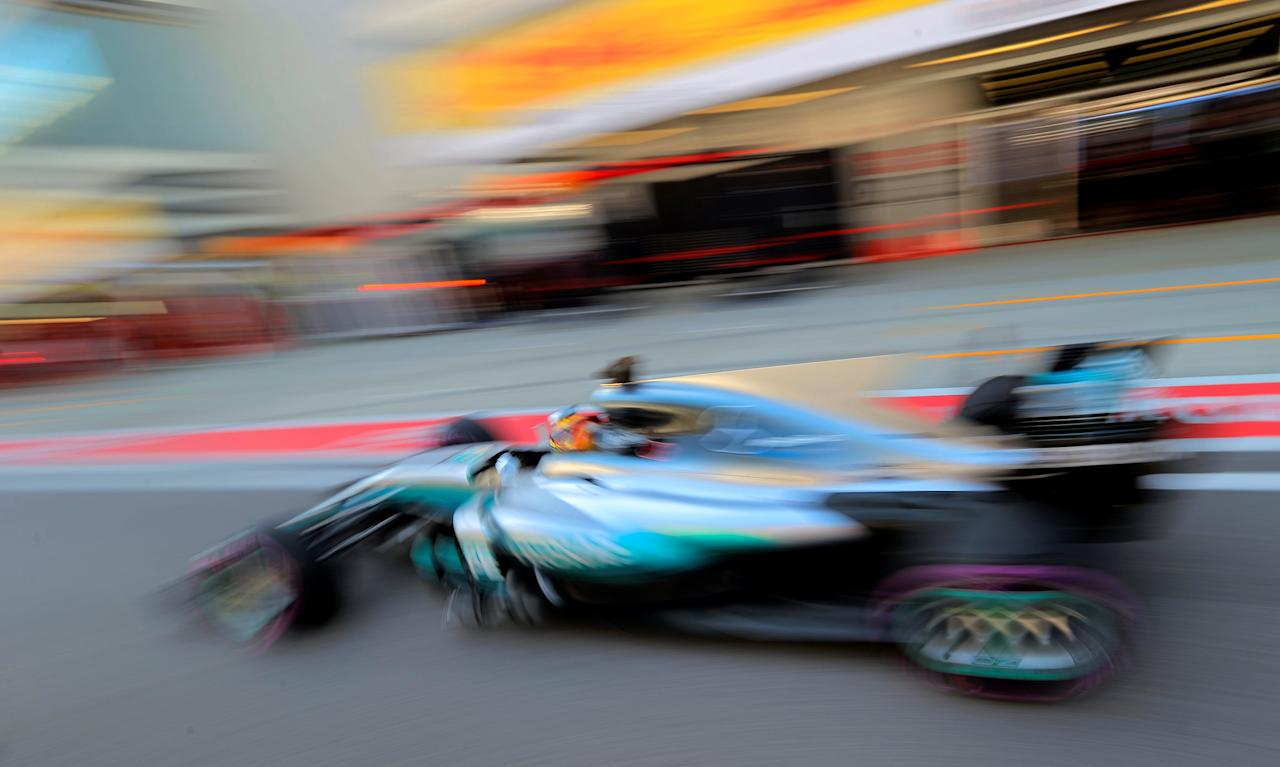 Formula One - F1 - Russian Grand Prix - Sochi, Russia - 29/04/17 - Mercedes Formula One driver Lewis Hamilton of Britain drives in the pit lane during the qualifying session. REUTERS/Yuri Kochetkov/Pool