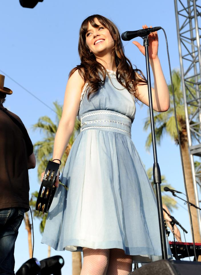 <p>Zooey Deschanel performed with She & Him in 2010, wearing a prim light blue sundress.</p>