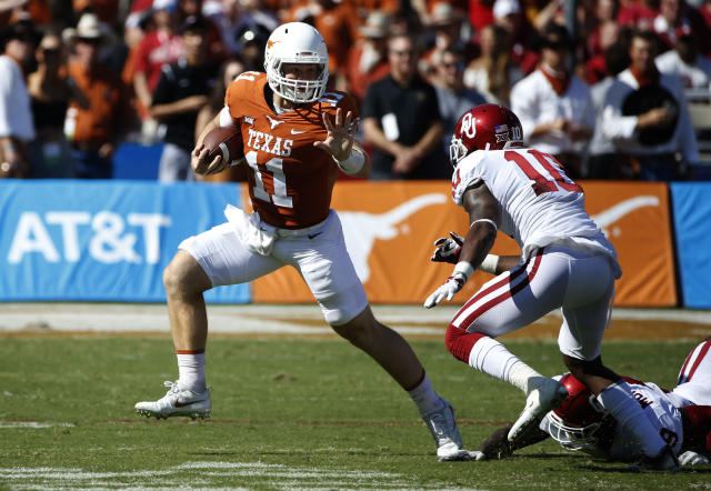 "Texas quarterback <a class=""link rapid-noclick-resp"" href=""/ncaaf/players/275098/"" data-ylk=""slk:Sam Ehlinger"">Sam Ehlinger</a> (11) tries to get past Oklahoma linebacker <a class=""link rapid-noclick-resp"" href=""/college-football/players/275222/"" data-ylk=""slk:Kenneth Murray"">Kenneth Murray</a> (9) and cornerback <a class=""link rapid-noclick-resp"" href=""/ncaaf/players/267597/"" data-ylk=""slk:Parnell Motley"">Parnell Motley</a> (11) during the first half of an NCAA college football game Saturday, Oct. 14, 2017, in Dallas. (AP Photo/Ron Jenkins)"