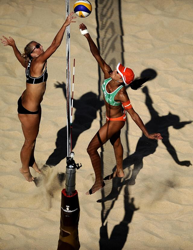 Hana Klapalova of the Czech Republic (L) spikes a ball against Brasilian Juliana Felisberta Silva during the FIVB Beach Volleyball World Championships in Rome's Foro Italico, on June 18, 2011. AFP PHOTO / Filippo MONTEFORTE (Photo credit should read FILIPPO MONTEFORTE/AFP/Getty Images)