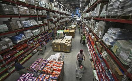 Customers shop at a Best Price Modern Wholesale store, a joint venture of Wal-Mart Stores Inc and Bharti Enterprises, at Zirakpur in Punjab June 8, 2012. REUTERS/Ajay Verma/Files