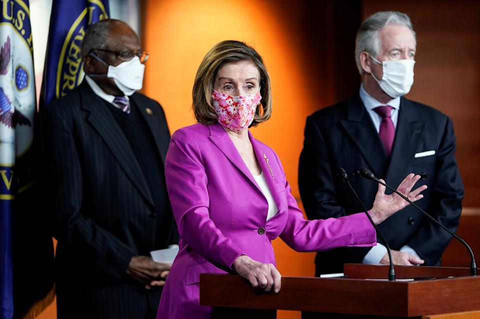 U.S. Speaker of the House Nancy Pelosi (D-CA) is flanked by House Majority Whip Jim Clyburn (D-SC) and House Ways and Means Committee Chairman Richard Neal (D-MA) as House Democrats hold a news conference ahead of the final House passage of the Biden administration's $1.9 trillion coronavirus disease (COVID-19) relief bill on Capitol Hill in Washington, U.S., March 9, 2021. REUTERS/Joshua Roberts