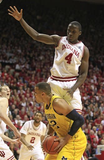 Michigan's Jordan Morgan puts up a shot while being defended by Indiana's Victor Oladipo during the first half of an NCAA college basketball game Thursday, Jan. 5, 2012, in Bloomington, Ind. (AP Photo/Darron Cummings)