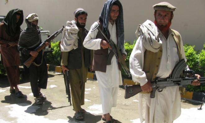 Taliban militants attend a surrender ceremony in Afghanistan on June 18.