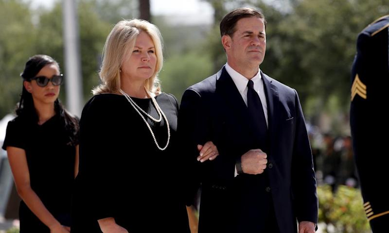 Governor Doug Ducey of Arizona and his wife Angela Ducey, at a memorial service for Senator John McCain in Phoenix on Wednesday. Ducey must name a replacement to fill McCain's Senate seat.