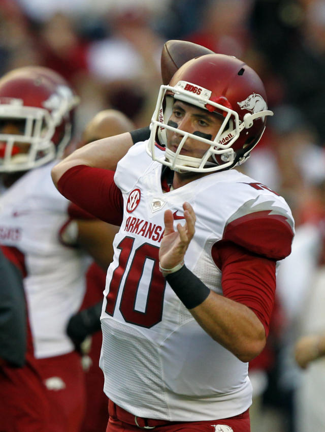 Arkansas quarterback Brandon Allen (10) throws a pass as he warms up before the first half of an NCAA college football game against Alabama on Saturday, Oct. 19, 2013, in Tuscaloosa, Ala. (AP Photo/Butch Dill)